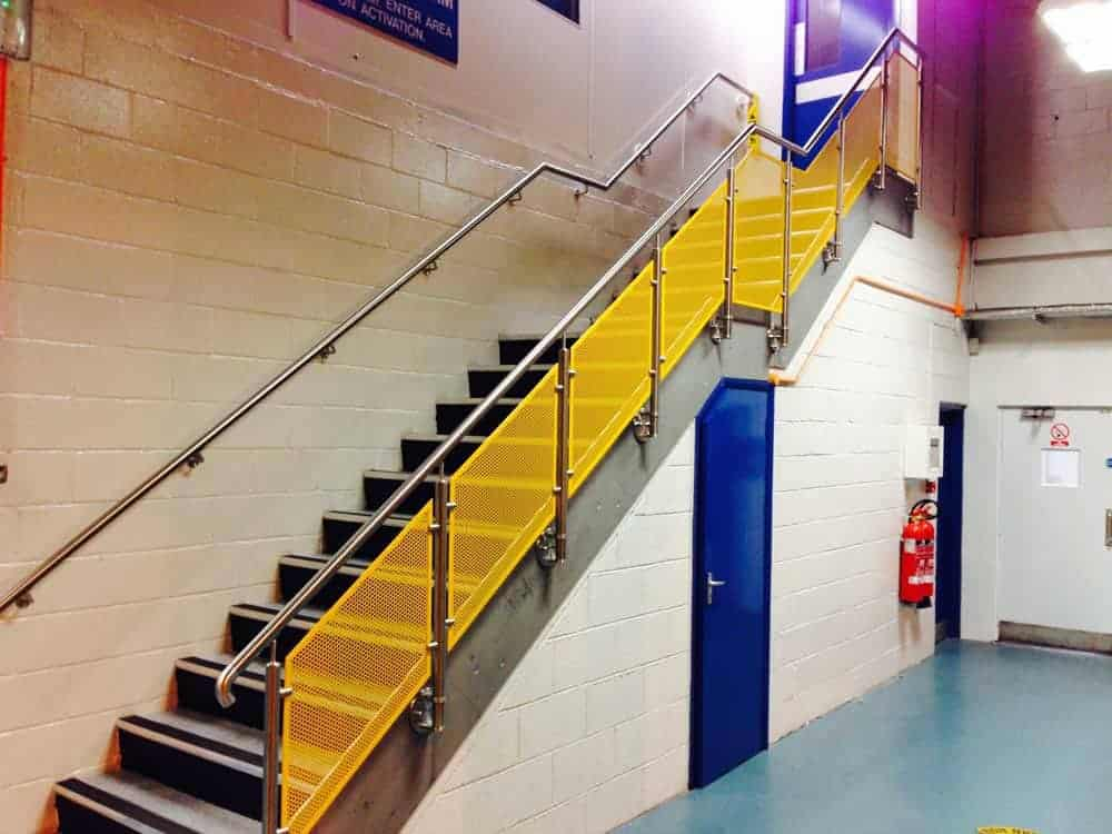 Old staircase updated with stainless handrails and powder coated infill panels